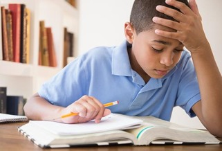 getty_rf_photo_of_boy_doing_homework